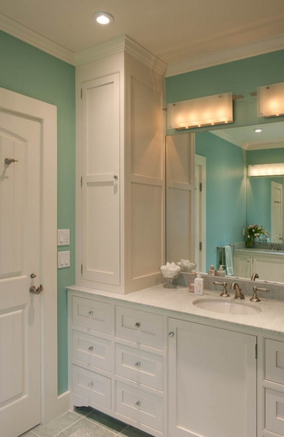 Vertical Storage solves many storage issues in a small bathroom like this one designed by Boston Interior Designer Elizabeth Swartz Interiors