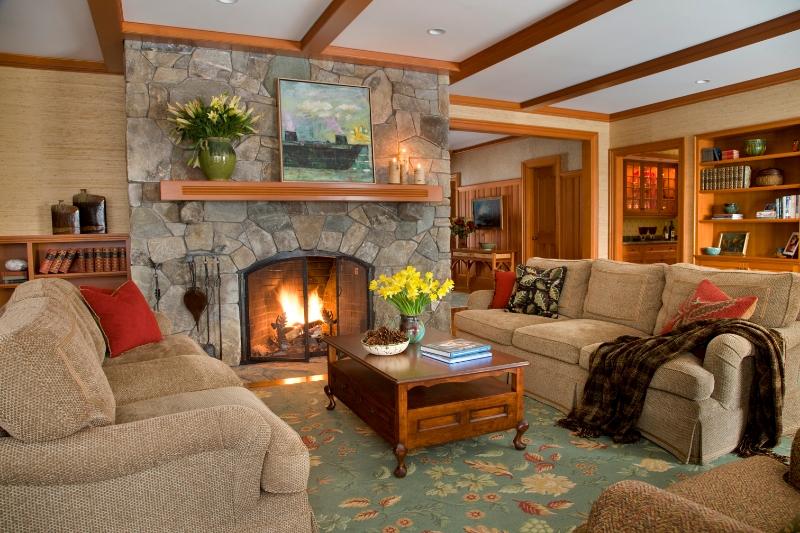 This cozy living room designed by Elizabeth Swartz Interiors features a custom designed rug.