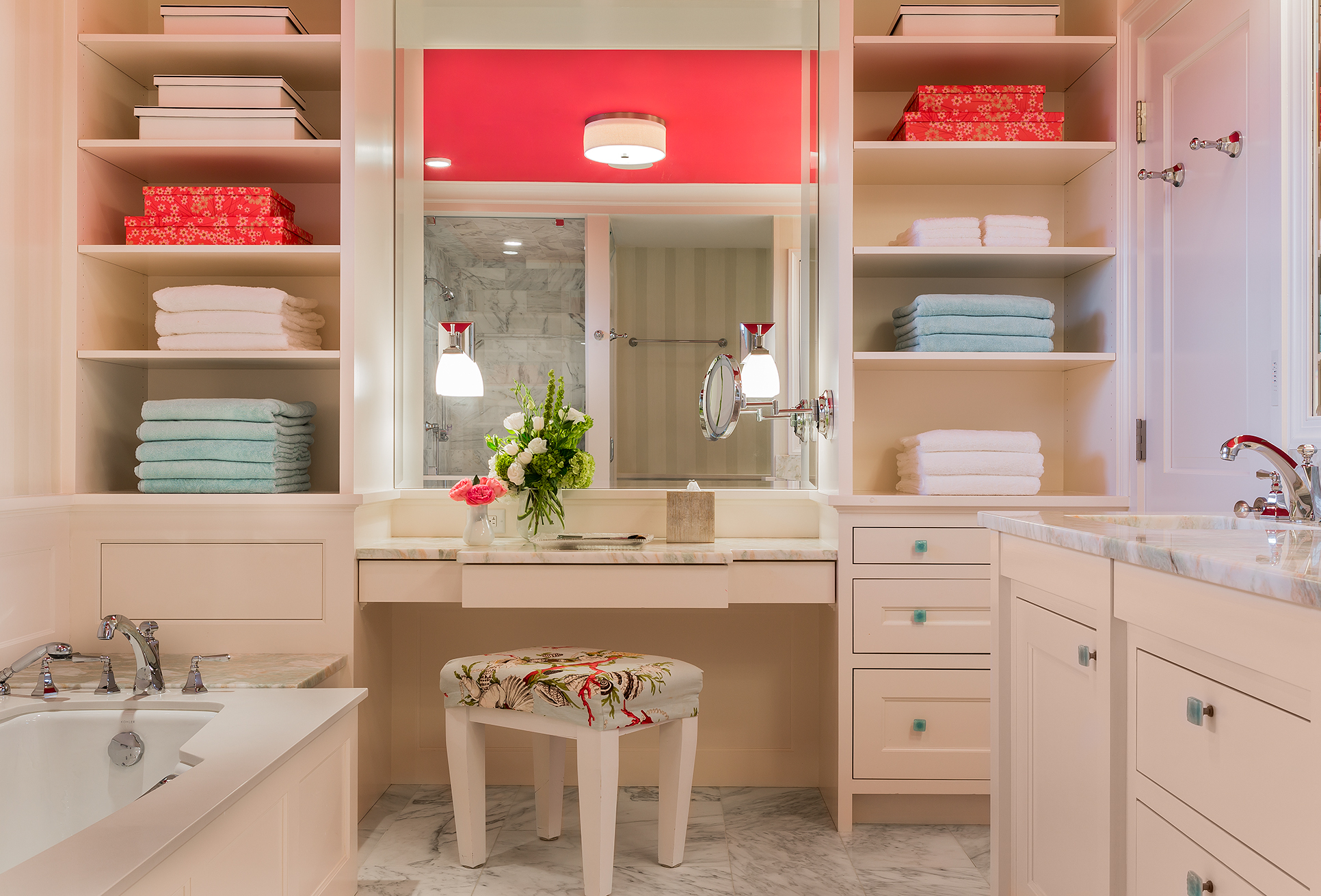 Custom shelving helps to keep this bathroom design organized in this bathroom by Boston Interior Designer Elizabeth Swartz Interiors