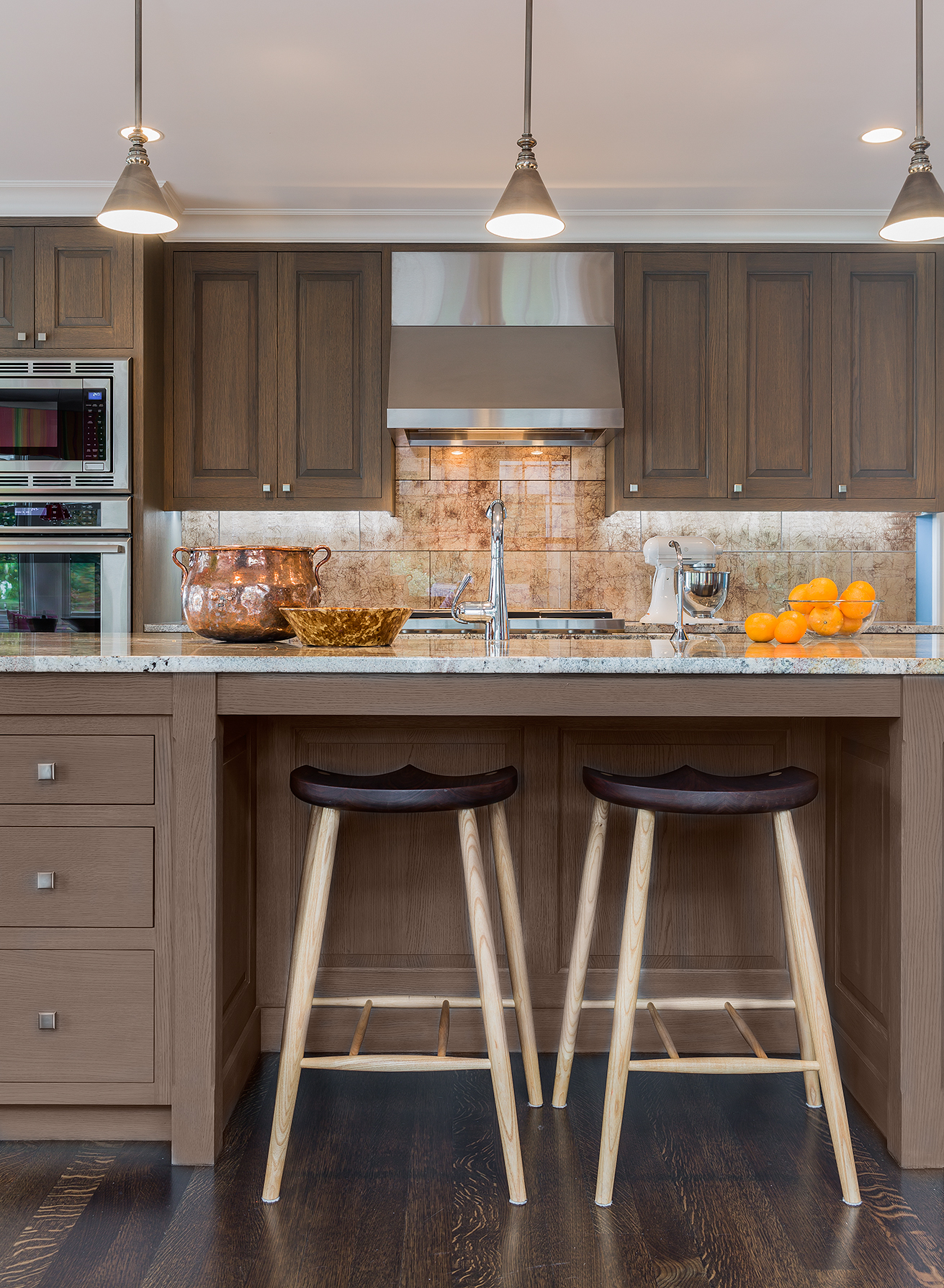 Interior design and kitchen lighting plan by Elizabeth Swartz Interiors of Boston that incorporates pendant lights over the island for task lighting.