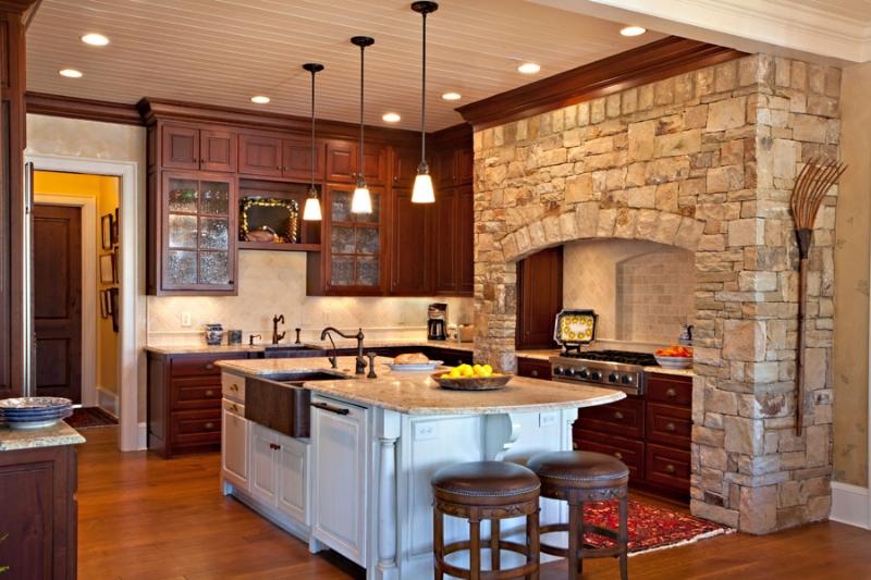 This kitchen by Boston Interior Designer Elizabeth Swartz Interiors utilizes an appropriate kitchen lighting plan that features ambient lighting, accent lighting and task lighting.