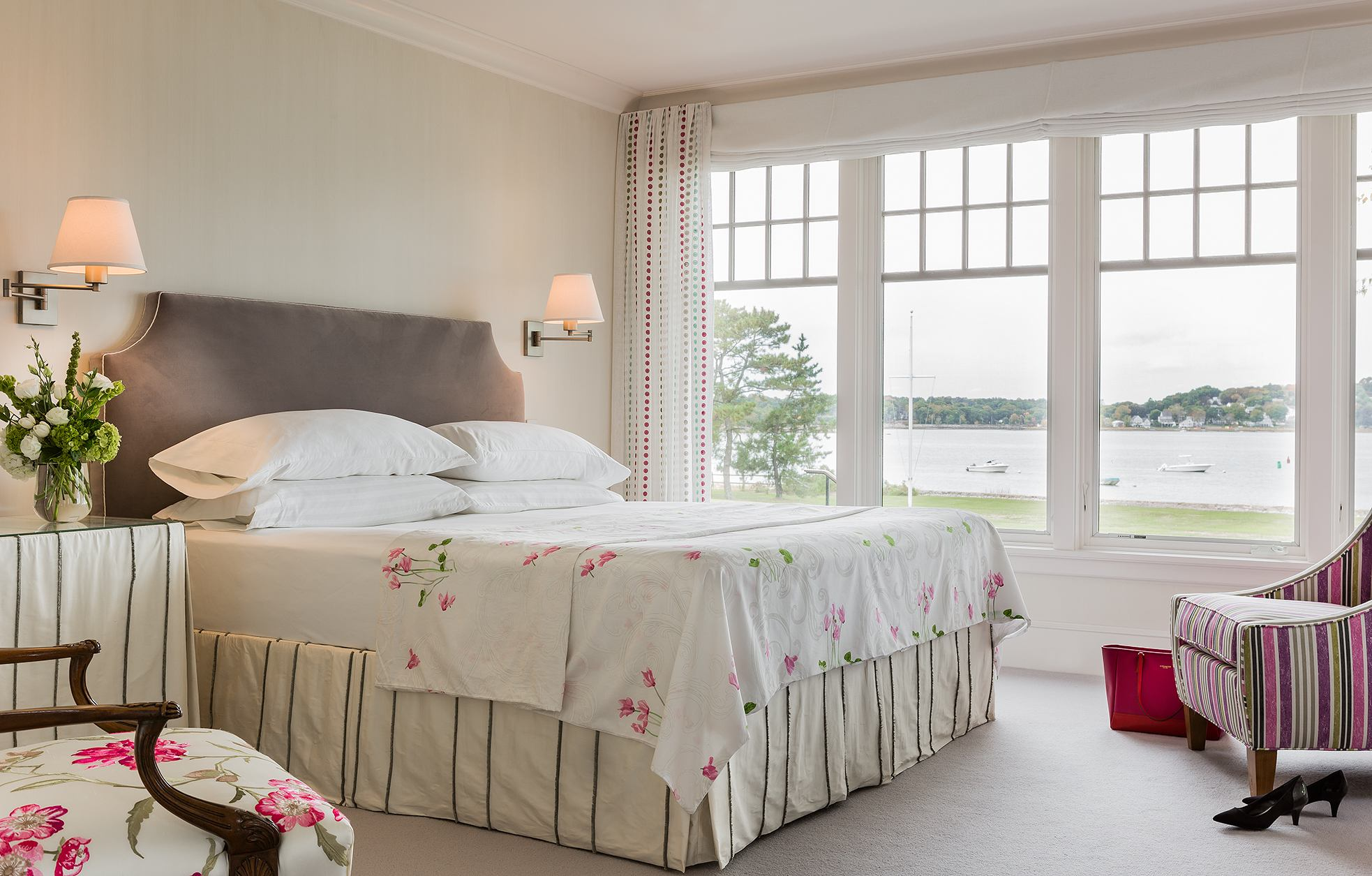 This waterfront bedroom by Elizabeth Swartz Interiors of Boston flirts with romance by using hints of pink flowers in both the bed linens and the chairs. The clean lines and and light colors are romantic in a clean, simple, understated way. Photo: Michael J. Lee