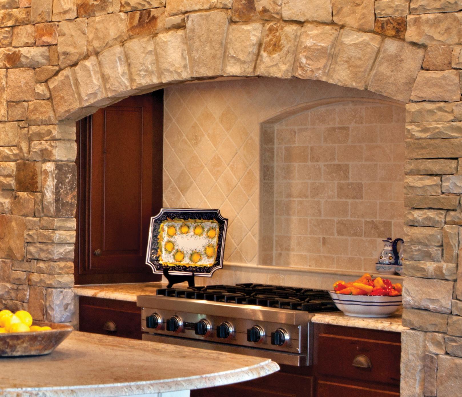 rustic stone alcove kitchen backsplash by Elizabeth Swartz Interiors