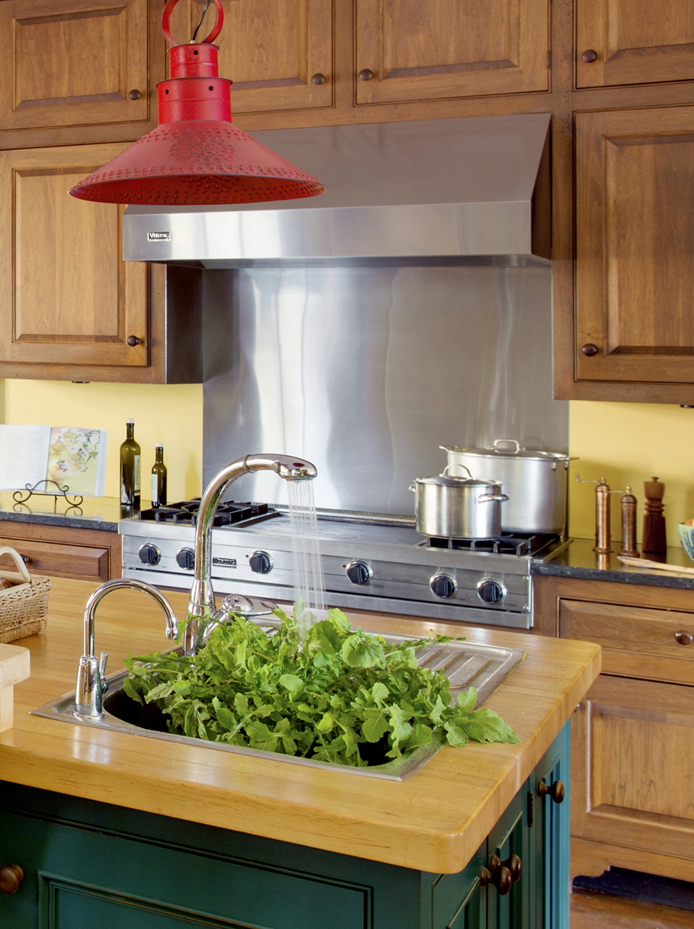stainless steel stovetop kitchen backsplash by Elizabeth Swartz Interiors