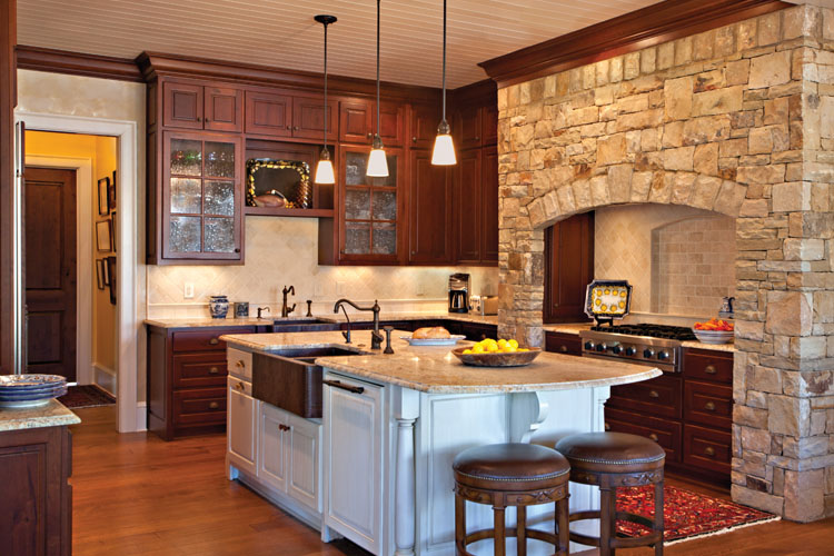 The large family kitchen of a Georgia lake house with interior design by Boston Interior Designer Elizabeth Swartz Interiors.