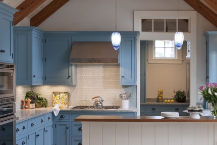 Kitchen of this Martha's Vineyard beach cottage that was transformed with cool blues, warm woods and natural finishes, interior design that reflects the home's island roots.