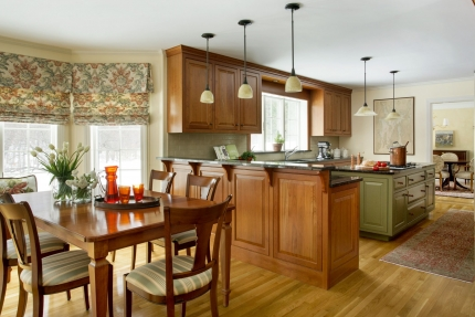The kitchen of this Boston-area home features a modern interior with traditional colonial architecture and custom cabinetry. Traditional Colonial Interior Design by Elizabeth Swartz Interiors.
