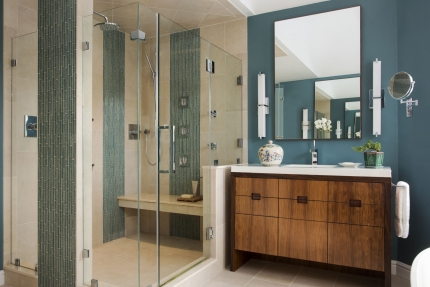 Bathroom of a contemporary interior design by Boston Interior Designer Elizabeth Swartz Interiors blending sophisticated materials such as natural stone, warm woods, and glass.