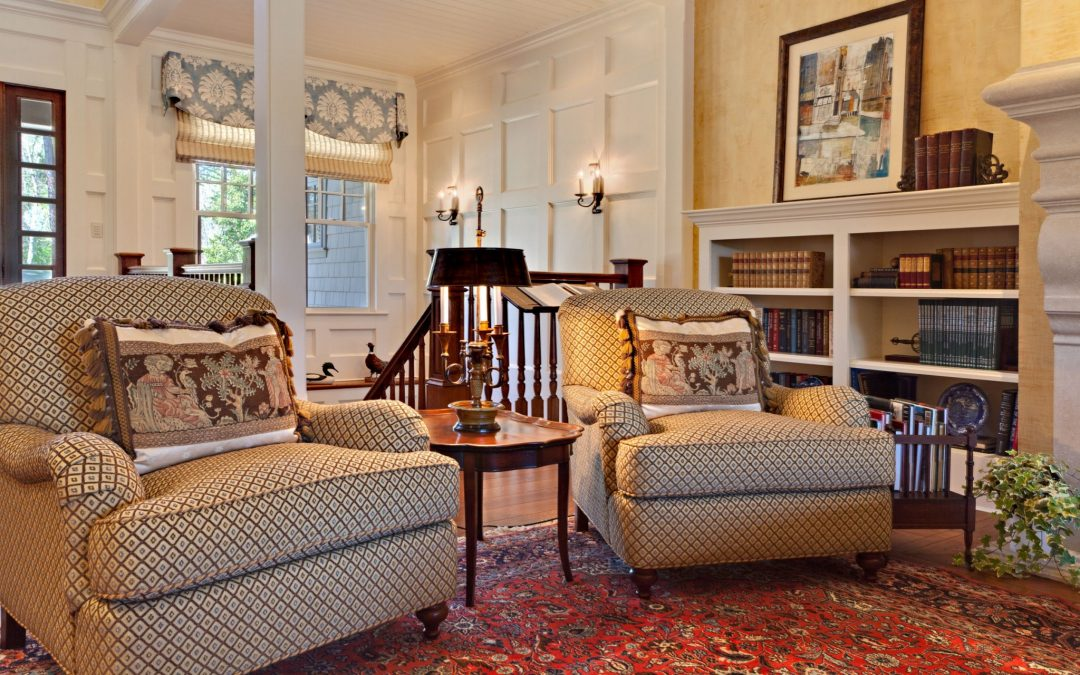 At the top of the stairs on the main level of this Georgia lake house is a formal living room designed  for entertaining and conversation by Boston Interior Designer Elizabeth Swartz Interiors.