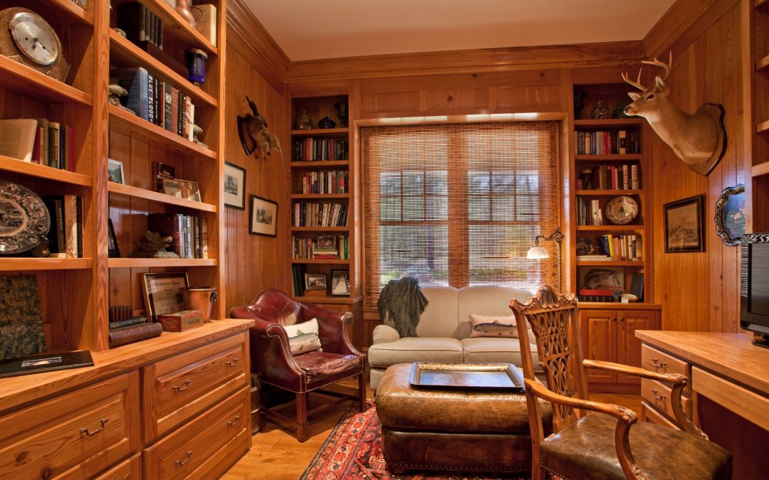 This Georgia vacation home on the lake even has a library. Library designed by Boston interior designer Elizabeth Swartz Interiors.