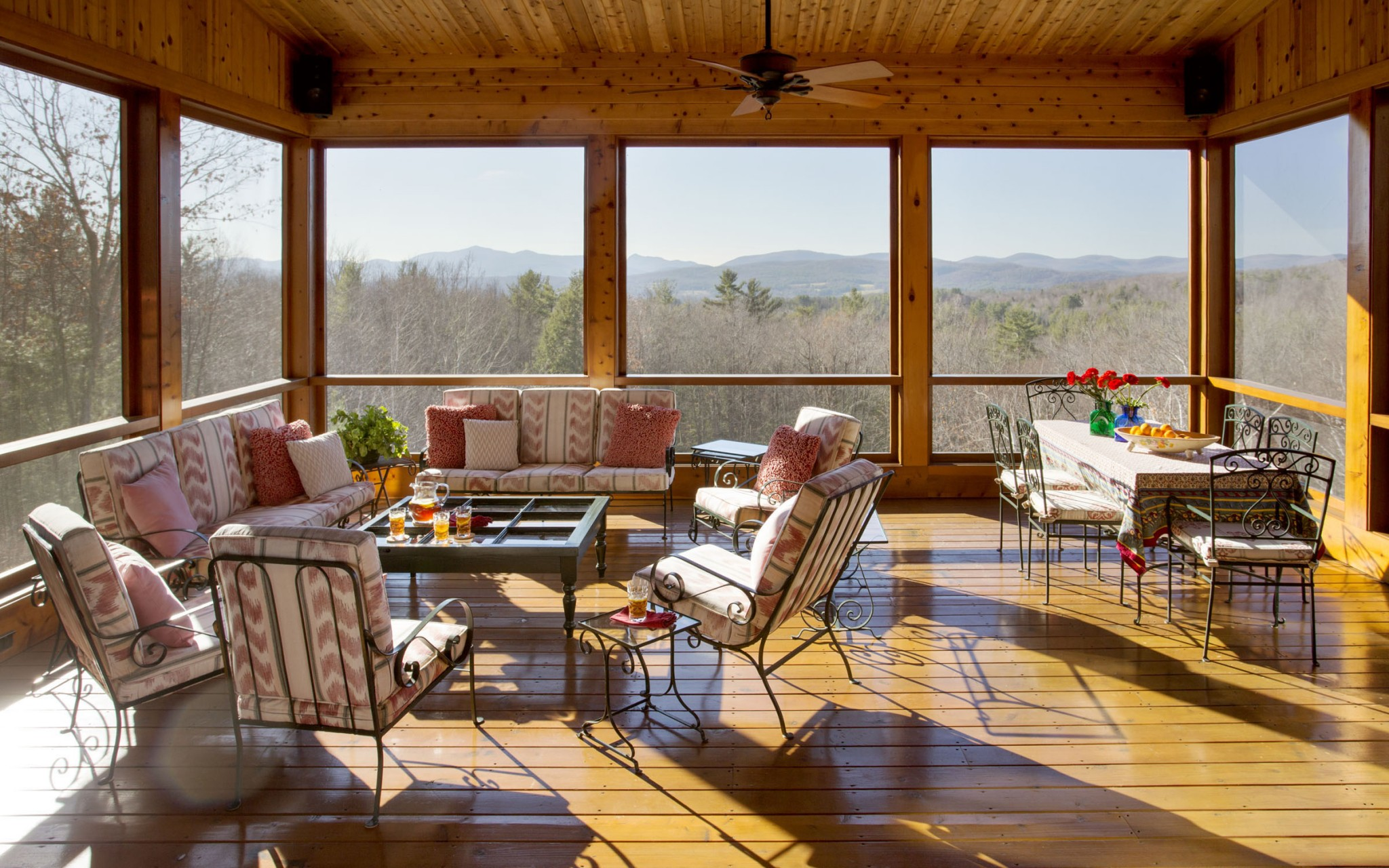 No Vermont farmhouse would be complete without a sun porch overlooking the Green Mountains. Interior design by Boston Interior Designer Elizabeth Swartz Interiors.