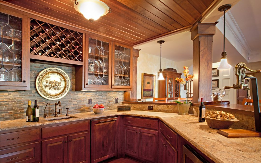 The kitchen in the entertaining area on the lower level of this lake house vacation home was designed by Boston interior designer Elizabeth Swartz Interiors.