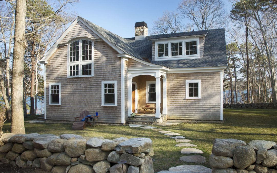 Although the square footage of this Martha's Vineyard home increased considerably, the exterior footprint and design stayed true to it's beach cottage roots and fits right in with it's surroundings on Lake Tashmoo.