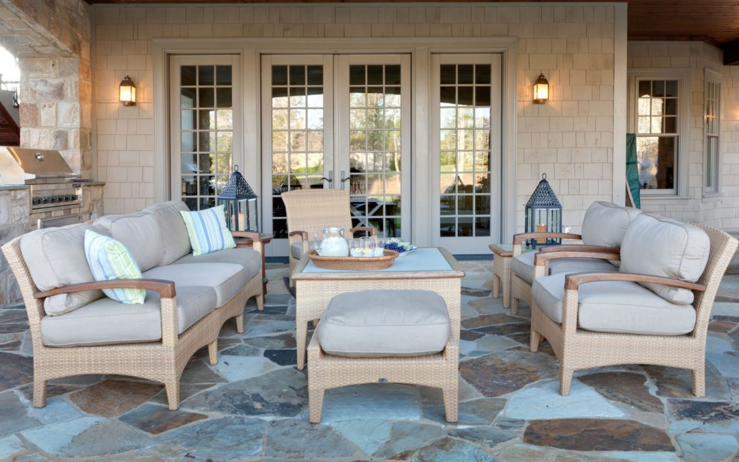 The patio off of the lower level game and family room offers easy access to the outdoors with plenty of shade.