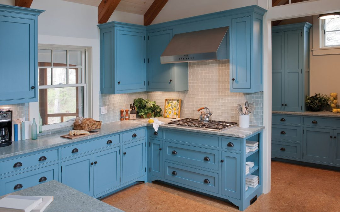 The interior design of the kitchen in this beach cottage on Martha's Vineyard by Boston Interior Designer Elizabeth Swartz Interiors features cool blues and warm woods reflecting the home's island roots.