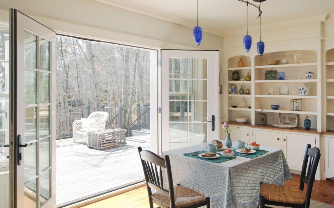 The interior design of this Martha's Vineyard beach cottage by Boston Interior Designer Elizabeth Swartz Interiors is versatile and designed for entertaining.