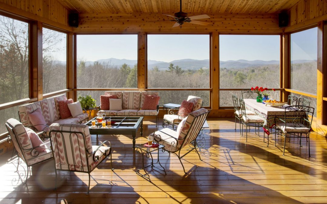 Screened in porch/sunroom of a Vermont home with interior design by Boston Interior Designer Elizabeth Swartz Interiors that was featured on a Houzz house tour.