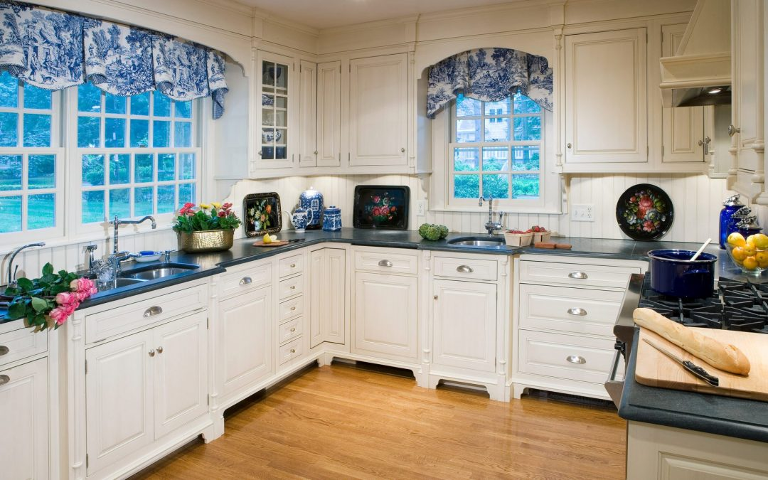 Three smaller rooms were combined by Boston Interior Designer Elizabeth Swartz Interiors to create a new kitchen and breakfast room.