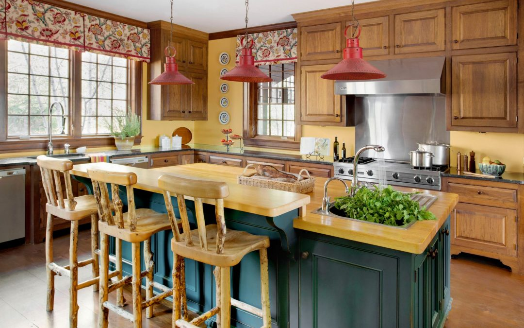 The kitchen of this newly constructed Vermont farmhouse by Boston Interior Designer Elizabeth Swartz Interiors combines contemporary design elements with traditional architectural details, rich colors and local materials.