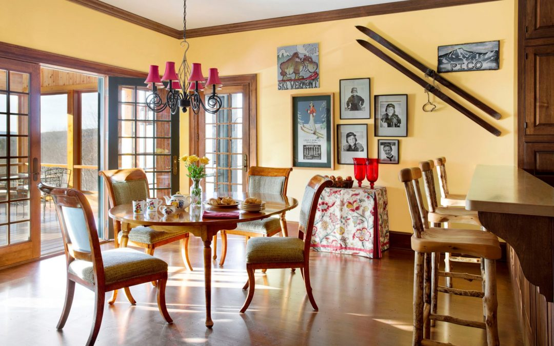 The casual eat in dining area off of the kitchen of this newly constructed Vermont farmhouse by Boston Interior Designer Elizabeth Swartz Interiors combines contemporary design elements with traditional architectural details, rich colors and local materials.