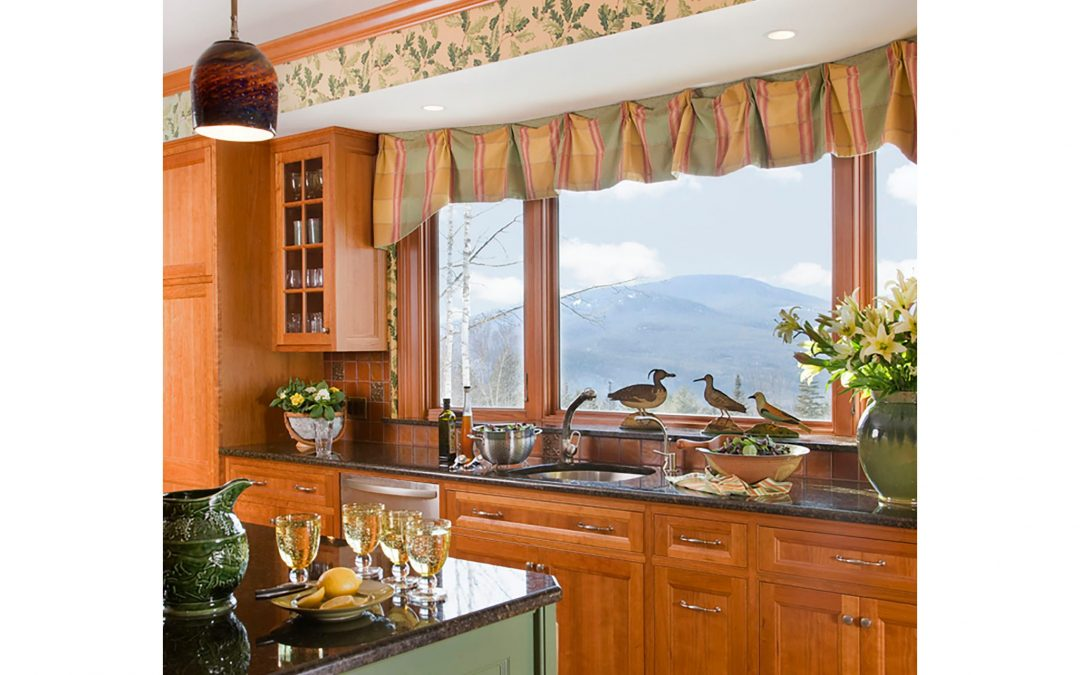 Custom window treatments frame the beautiful view of the White Mountains in this mountain retreat design by Boston Interior Designer Elizabeth Swartz Interiors.