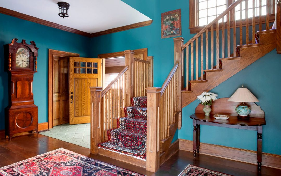 The main entry of this Vermont farmhouse by Boston Interior Designer Elizabeth Swartz Interiors combines contemporary design elements with traditional architectural details, rich colors and local materials.