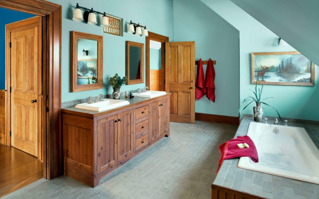 A bathroom in this newly constructed Vermont farmhouse by Boston Interior Designer Elizabeth Swartz Interiors combines contemporary design elements with traditional architectural details, custom cabinetry and local materials.