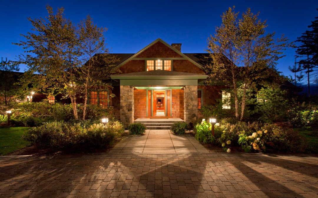 The main entrance of this White Mountain retreat designed by Boston Interior Designer Elizabeth Swartz Interiors makes a grand statement.