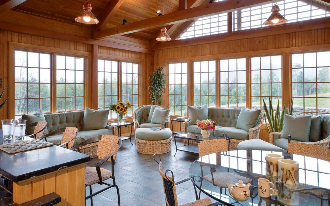 The Pool House in the White Mountain retreat features a great room for entertaining. Boston Interior Designer Elizabeth Swartz Interiors maintained the same color schemes and natural motifs throughout the pool house to create a cohesive look with the main home of this New Hampshire family retreat.