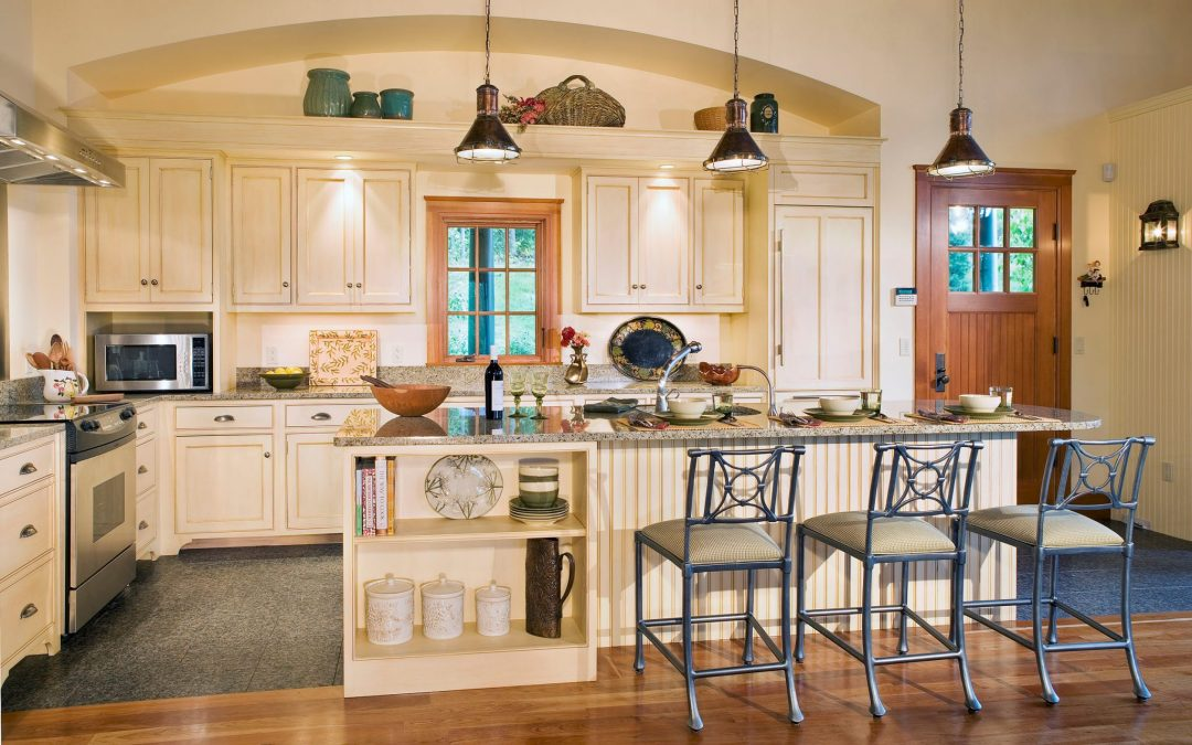 The guest house kitchen of this white mountain retreat features custom cabinetry and interior design by Boston Interior Designer Elizabeth Swartz Interiors.