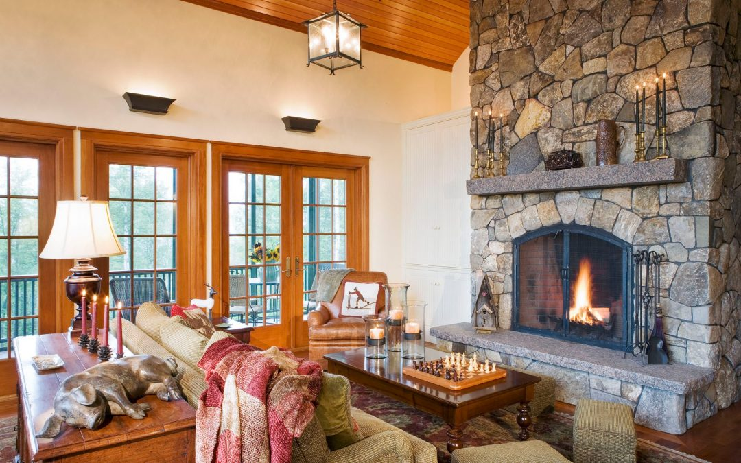 Cozy up next to the fire in the guest house of this White Mountain retreat with interior design by Boston Interior Designer Elizabeth Swartz Interiors.