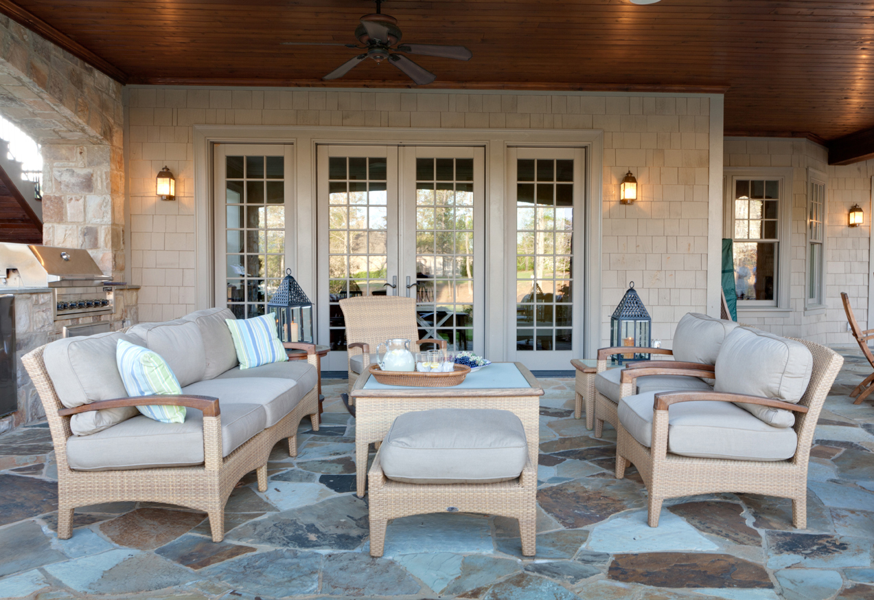 The colors of the custom-designed stone patio provided the inspiration for the soft blue-grey upholstery on this contemporary outdoor furniture designed by Boston interior designer Elizabeth Swartz Interiors.