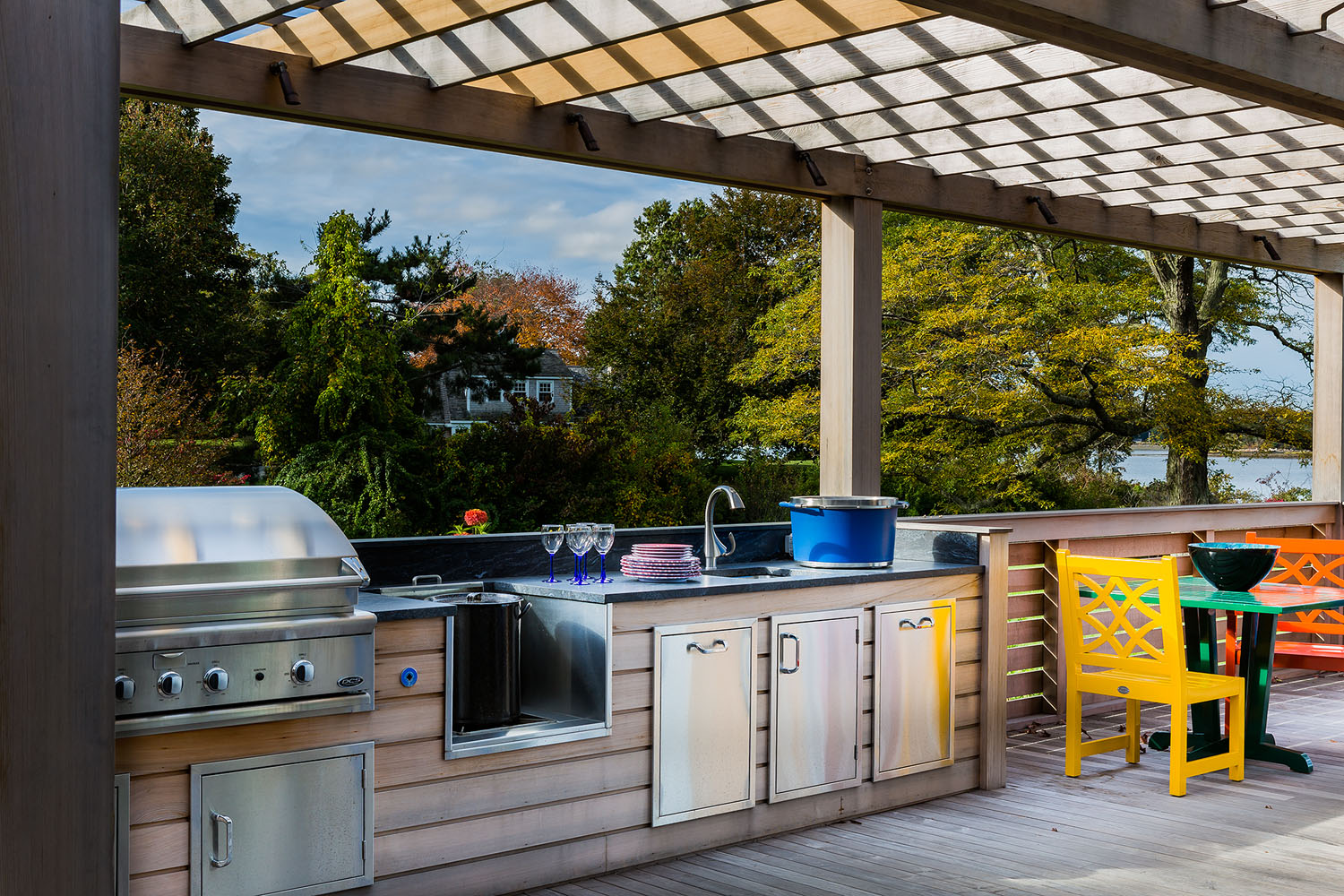 Living outdoors i easy in this space designed by Boston interior designer Elizabeth Swartz Interiors includes a complete kitchen .
