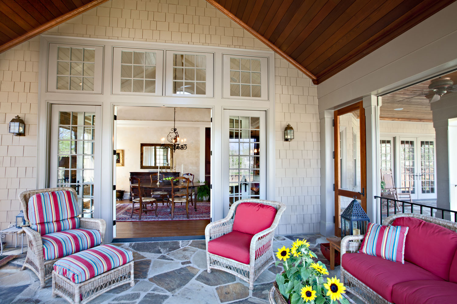 Boston interior designer Elizabeth Swartz Interiors designed the porch to coordinate with the interior of the home.