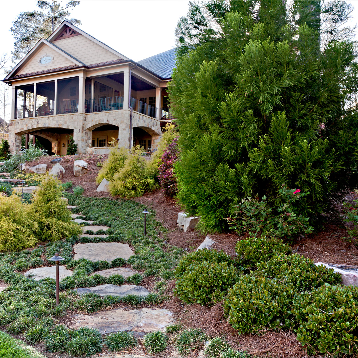A stone pathway from the house to the dock makes living outdoors easy.