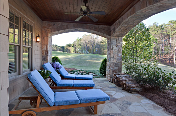 Bold blue hues from the interior were carried through on upholstered outdoor patio furniture in Elizabeth Swartz Interiors' lakeside project.